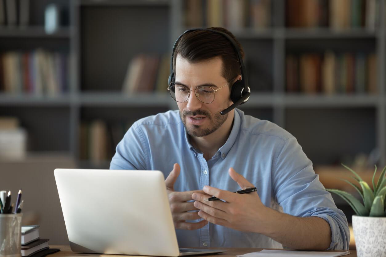 Man Having a Conversation Over the Internet
